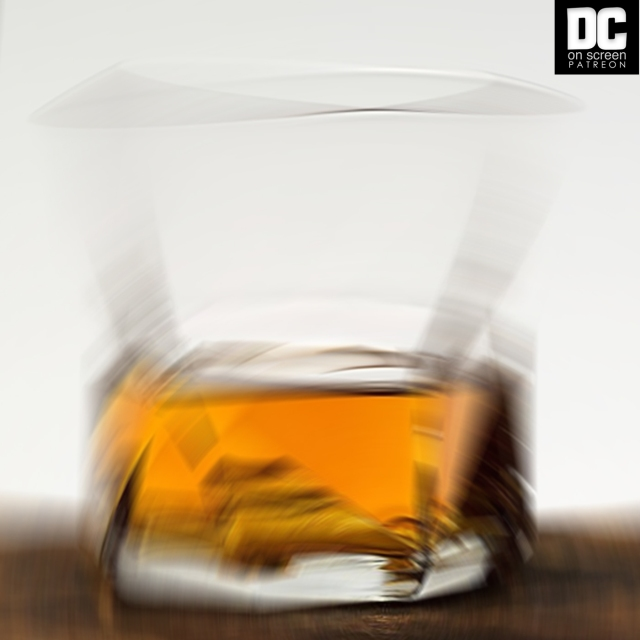 A blurry glass of scotch | DC on SCREEN